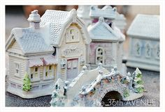 DIY Dollar Store Christmas Village by the36thavenue.com...one dollar + spray paint!