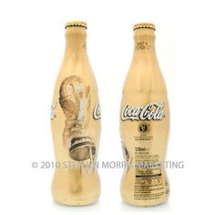 Coca Cola UK 2006 World Cup bottle - gold wrap - full and in perfect condition!