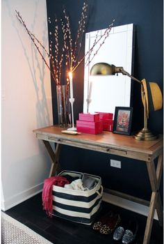 walls with contrast, west elm mirror, brass task lamp, hot pink