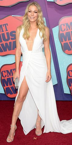 LeAnn Rimes really knows what color works best for her. Showing off a whole lot of skin (look at those gams!), the night's presenter stuns in her all-white Rani Zakhem gown.  http://www.people.com/people/gallery/0,,20823101,00.html#30167395