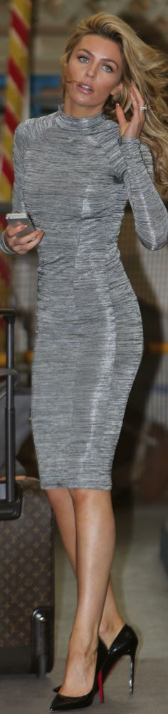 A turtleneck sweaterdress is indespensible for winter. Mine is black, but I love this silver! Abbey Clancy