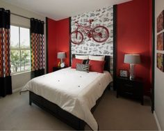 I love the walls, the curtains, the simple, modern furniture and the bike accent. This room is perfect for the preteen turning teenager that loves BMX!