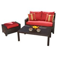 """Hand-woven outdoor loveseat, ottoman, and coffee table with bronze powder-coated aluminum framing. Loveseat and ottoman have fade-resistant cushion covers.  Product: Loveseat, ottoman and coffee table Construction Material: Polyethylene wicker, powder coated aluminum and polyfillColor: Crimson redFeatures:  Made from 100% recyclable materialUV, weather and fade resistant Dimensions: Loveseat: 31"""" H x 55"""" W x 33"""" D Ottoman: 17"""" H x 29.5"""" W x 20"""" D Coffee Table: 16"""" H 46"""" W x 26"""" D Note…"""