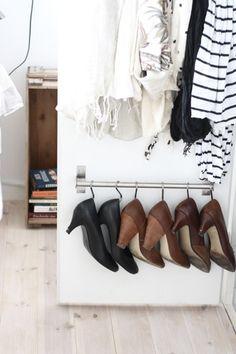 Easy shoe storage using IKEA's BYGEL rail and a few S-hooks