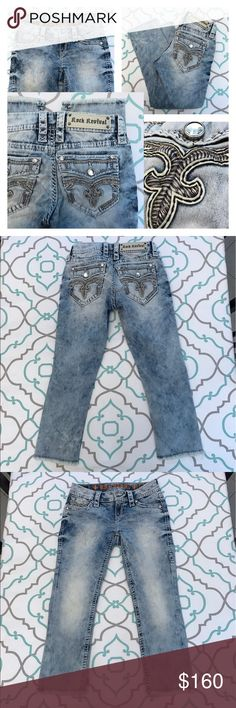 "💙👖Awesome Rock Revival Capris👖💙25 0 22"" Light! 💙👖Awesome Rock Revival Jeans👖💙 Size 25 (0). 22"" Inseam. 7"" Rise. 13.5"" Across Back. Amazing Stretch. Acid Washed to a Light Color with Hint of Dark awash Remaining. Rilkin Crop. Capri. Cropped. Shorts. Crops. Thick Stitching. Bling! Fleur De Lis with a linear stitching pattern in the middle. Faux Flaps Back Pockets. Very Cute!!!! Awesome! And So Unique! Rocks! The Buckle! Ask me any questions! : ) Rock Revival Jeans Ankle & Cropped"