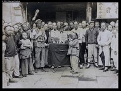 "China, 1905 ""Visualising, at a peep show stall, probably in Shanghai"""