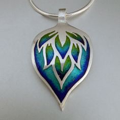 Deep blue, green, and turquoise enamelled pendant, fine silver