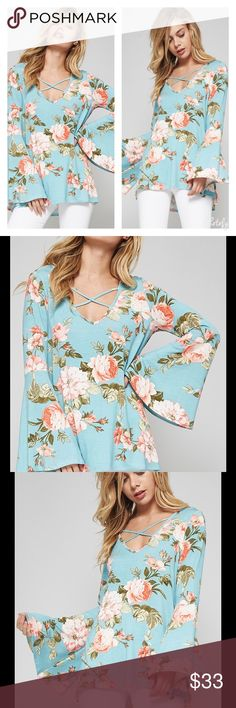 SALE!!BEAUTIFUL BLUE FLORAL BELL SLEEVE TOP Beautiful Blue Floral Bell Sleeve Top Pretty Crisscross V-Neck Lovely Bell Sleeves Soft Material   Sizes S, M, L Rayon/Spandex  NO TRADES Peach Couture Tops