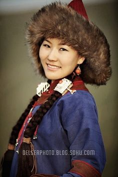 Mongolian woman in traditional costume and hat
