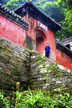 Taoist monk relaxing by the temple, Wudang Mountains, China
