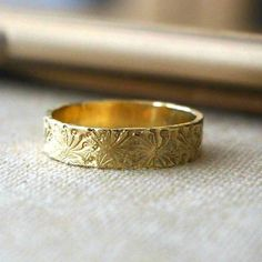 Wedding Band Ring, 14k Gold Ring, Timeless Rings, Campo di Fiori Collection, Bridal Jewelry, Unisex Rings, Handmade Rings, Venexia Jewelry. This romantic unique wedding band is hand crafted in 14K yellow gold, reflecting the warm radiance of your timeless love. A beautifully unique symbol of your commitment, the ring will continue to delight as the years go by. 14K yellow gold band handmade to order featuring a pattern artisan finish, dainty and feminine. Stunning simplicity truly makes a…