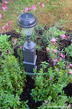 One yard sale lamp + a can of paint + a solar light = a totally unique garden decor piece. #Upcycle #Gardendecor #Repurpose