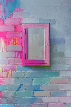 Close up section of a vibrant outdoor mural with pops of neon pink, green and blue. The paint covers the bricks and objects of the wall, creating one giant outdoor canvas. Wall Decor, Room Decor, Wall Art, Painted Wall Murals, Deco Surf, Ideias Diy, Paint Designs, House Colors, Decoration