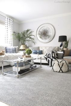 ivory leather sofas with blue shibori and jeans pillows | neutral eclectic living room with blue accents | shibori pillows | jeans pillows | black and white accents | mixing metals |