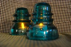 Glass insulators as nightlights with Dollar Tree battery flicker lights under them