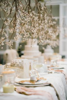 Stunning #winter wedding! These #branches give the space a #chic, #romantic vibe.