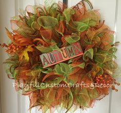 """This gorgeous Autumn wreath would look stunning on your front door to welcome in Autumn. It is made on a 12"""" wire frame and measures 20"""" across."""