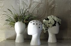 Wig, a white ceramic vase by Tania de Cruz that allows the user to create insanely artistic headdresses through the placement of florals and greenery.