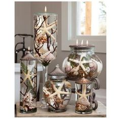 Distinctive Lifetime Oil Burning candles from White River Designs that capture nature's beauty for years to come. Natural shells are sealed inside the glass decorative container with a separate wick i