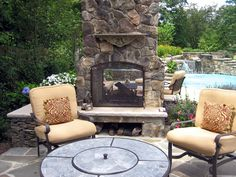 DIY Network | 12 amazing outdoor fireplaces and firepits ... two-sided fireplace
