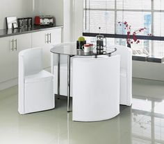 A unique and stylish dining set that's part of the Urban Revival look at Argos. The table has a metal frame with chrome legs and a modern, black glass table top finish. The 4 white leather effect chairs fit perfectly together underneath the table. A perfect dining set for smaller kitchen and dining spaces.