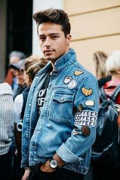 His denim jacket with patches.