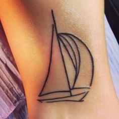 Simple sailboat tattoo