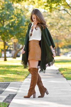 Try a lighter weight shall as an alternative to a heavy jacket for those warmer fall days.