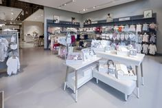 In a layout zoned into 'worlds' based on new parents' key shopping missions, the popular categories of Baby Fashion, Home, Service, Gifting and Travel are now joined by a Maternity offer. Visual Merchandising, Baby Store Display, Fashion Retail Interior, Brick Feature Wall, Uk Retail, Retail Stores, Glasgow Uk, Childrens Shop, Retail Concepts