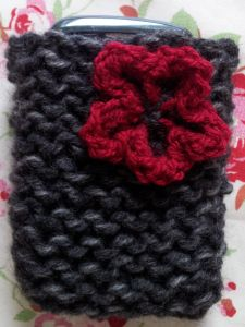Quick Knit Phone Case - If you are looking for fast and simple beginner knitting patterns, you will love the Quick Knit Phone Case. This DIY phone case is one of the fastest knitting projects you will ever take on and is perfect for novice knitters. Learn how to make a phone case that has a classic look with a little embellishment for flair that you are sure to love. This phone cover makes for great last minute gifts for friends. Not only will they love that they can use it, but they will feel s