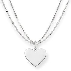 THOMAS SABO necklace from the Sterling Silver Collection. - Engravable token of love - Romantic statement - Playful sophistication Close to the heart: the feminine engravable double chain with its heart pendant conveys delicate love through the playfulness of this item of jewellery in a sophisticated manner. [Artikeltabelle]Category:necklace Material:925 sterling silver Clasp:lobster clasp Measurements:Size approx. 1,5 cm (0,59 Inch), Width approx. 0,2 cm (0,08 Inch)…