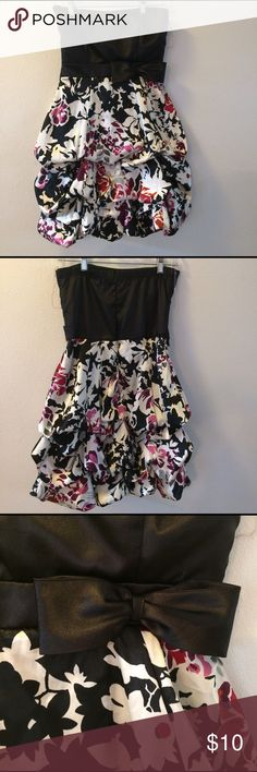 Black and floral formal strapless dress Only been worn once! The bottom of the dress is described a bubble style because it's pooled up and ruffled a little. There is a black bow on the left front side. The back top of the dress does have some elastic for some stretching. The zipper is on the back as well. 🔆I do ship as fast as possible                              🔆Have any questions I will answer them.         🔆I do bundle! Trixxi Dresses Strapless