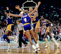 Magic Johnson, Byron Scott, Kareem Abdul Jabbar and Michael Cooper
