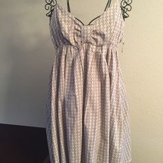 Lei summer dress Adorable tan Lei summer dress with adjustable straps like new lei Dresses Midi