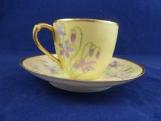 Yellow Tea Cup and Saucer with Purple Lilies and Gold Trim