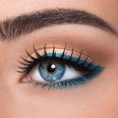 turquoise eyeliner and bronze eyes