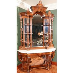 Victorian Renaissance Revival Carved And Gilt Rosewood Etagere By J. Ziegler & Co.  c.1880