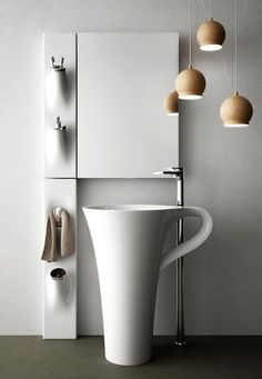 The #Italians do #porcelain sanitaryware like no other country in the world, and our friends at Artceram take it to the limit (in certain cases...) Case in point in their graceful and aptly shaped #Cupfreestandingbasin , not to mention the clever bathroom accessories mounted to the wall in their own softly sculpted porcelain holders. #esotericdesign #bathroomsinks #freestandingsinks #bathroomaccessories #sanitaryware #interiors #bathroomdesign #tradetoyoftheday #toystoretothetrade