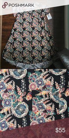 BNWT LuLaRoe Black Background Floral Carly Slinky material, beautiful Floral LuLaRoe Dresses