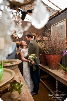 Lovely rustic winter wedding Niki & Andrew by Kat Forsyth at Petersham Nurseries.  Buckets of branches.