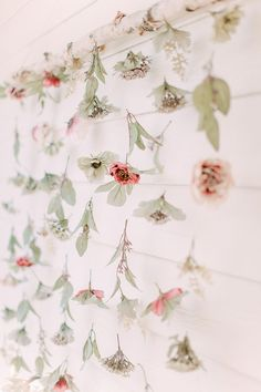 A garden party calls for an Instagram-worthy floral backdrop. The host of this bridal shower got creative and handmade this dreamy installation using various blooms and greenery.