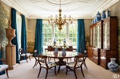 The antique chandelier in the dining room of this California home is from Florian Papp | archdigest.com