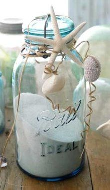 Ways to Decorate Jars & Bottles Beach Style  Decorate Jar Beach Style  Here are a few ideas how you can decorate jars and bottles beach style. Add some sea treasures with raffia, via Country Home...    decorate bottles beach style  ... or attach some fun tags.    jars with twine ribbons and shells  Use shells on a string, seen at HGTV.    decorate jar with twine and shells  Make a twine wrap, spotted at The Lisa Porter Collection.    decorated jars with twine and shells  More lovely Jars Deco...