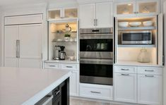 Keep your kitchen slick and eat with microwave and coffee makers and all of the tools that they need in cabinets that you can throw open as needed, or closed when not in use. Basic Kitchen, Kitchen Tops, Kitchen Linens, Kitchen And Bath, Coffee Station Kitchen, Coffee Bars In Kitchen, Coffee Bar Home, Kitchen Styling, Kitchen Storage