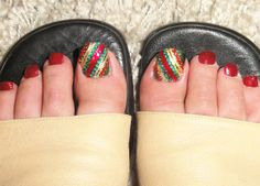 Xmas themed toenails. China Glaze Ruby Pumps, Champagne Bubbles and Glittering Garland, red and green rhinestones and gold striping. Shoes: LK Bennett.