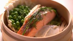 Martha uses a bamboo steamer to create a healthy salmon dinner in a snap. With simple ingredients, Martha's steamed salmon and peas are easy and delicious to make.