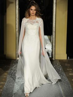 fit and flare embellished wedding dress with an illusion neckline and a matching cape