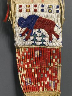 Sioux Beaded Fringed and Painted Pictorial Hide Tobacco Bag (close-up). ----- was auctioned at Sotheby's. Such items should not be auctioned off, they should be returned to the family! Native American Regalia, Native American Artifacts, Native American Beadwork, Native American History, Sioux, Loom Beading, Beading Patterns, Beading Tutorials, Bracelet Patterns
