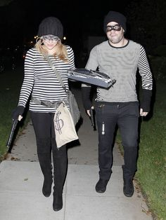 Pregnant Hilary Duff and her husban were robbers for Halloween last year. The fake money bags and toy guns are pretty cute!