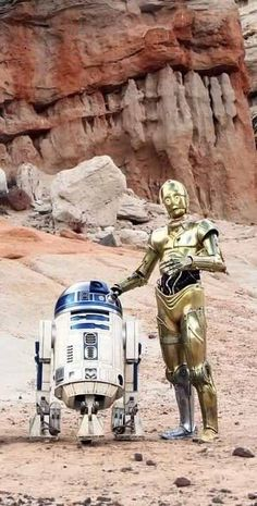 Kenny Baker and Anthony Daniels as R2-D2 and C-3PO in Star Wars: Episode IV - A New Hope.